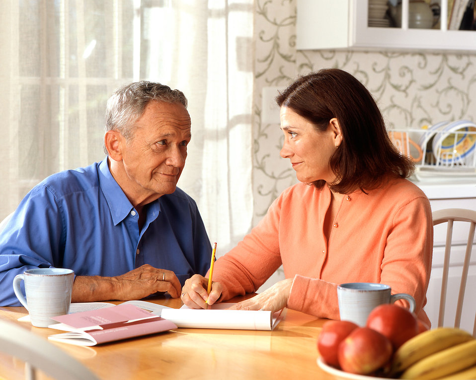 A woman and older man sitting at a table having a