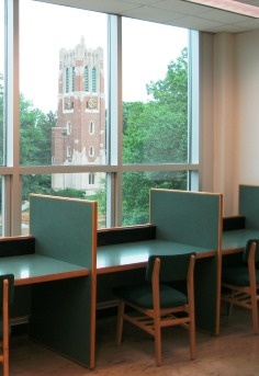 study carrels with view of Beaumont Tower