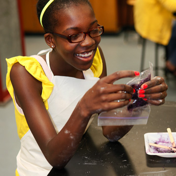 Girl experimenting at the Boston Museum of Science
