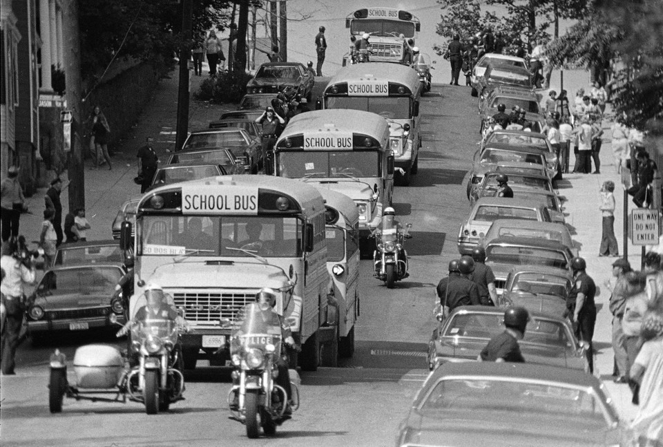 1974 photo of police escorting busses