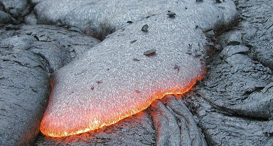 Basalt lava flow, with glowing edges on lava tongue