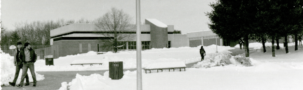 Image shows a snow-covered campus view of the library