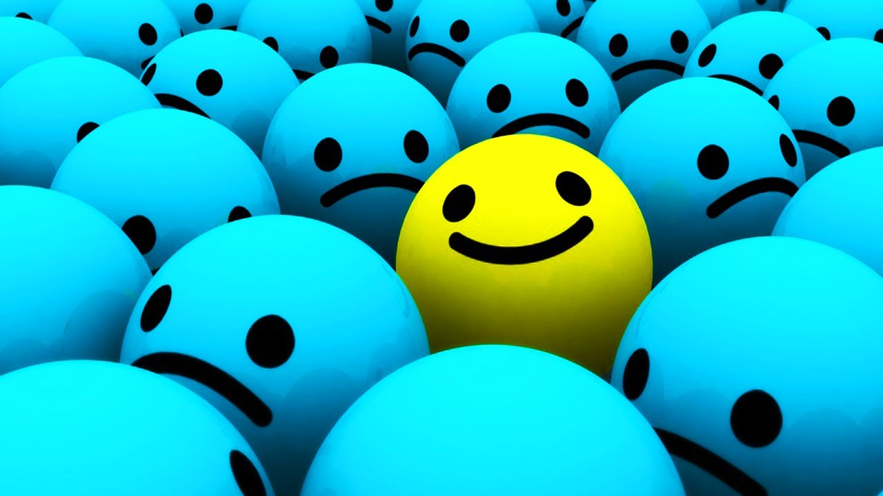 group of balls with sad faces, different coloured ball with smiling face