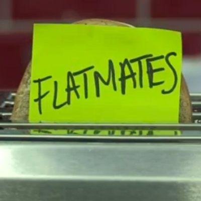 Photograph of sticky note saying Flatmates attached to toast in a toaster