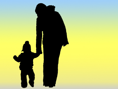 silhouette image of parent holding small child's hand