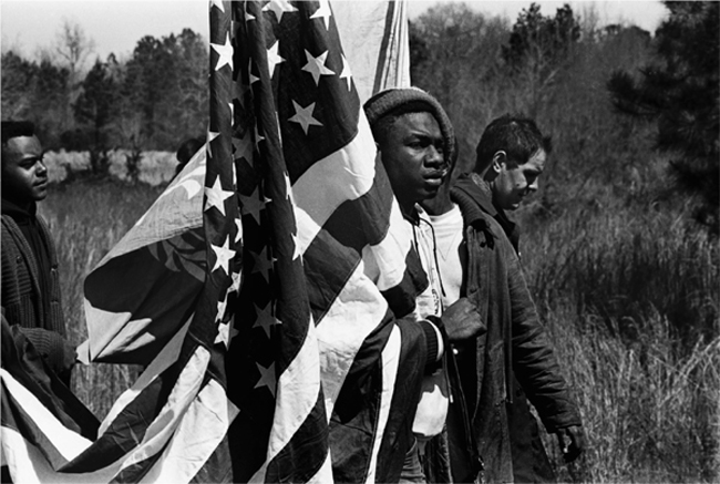 In the march to register voters, thousands of protesters walked fifty-four miles from Selma to Montgomery to bring awareness to the low number of registered black voters in the South in March 1965. Photograph by Jack Hopper.  BIRMINGHAM NEWS/POLARIS