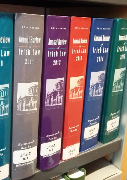 Photo of the colourful volumes of the Annual Review of Irish Law on a shelf in the Squire Law Library.