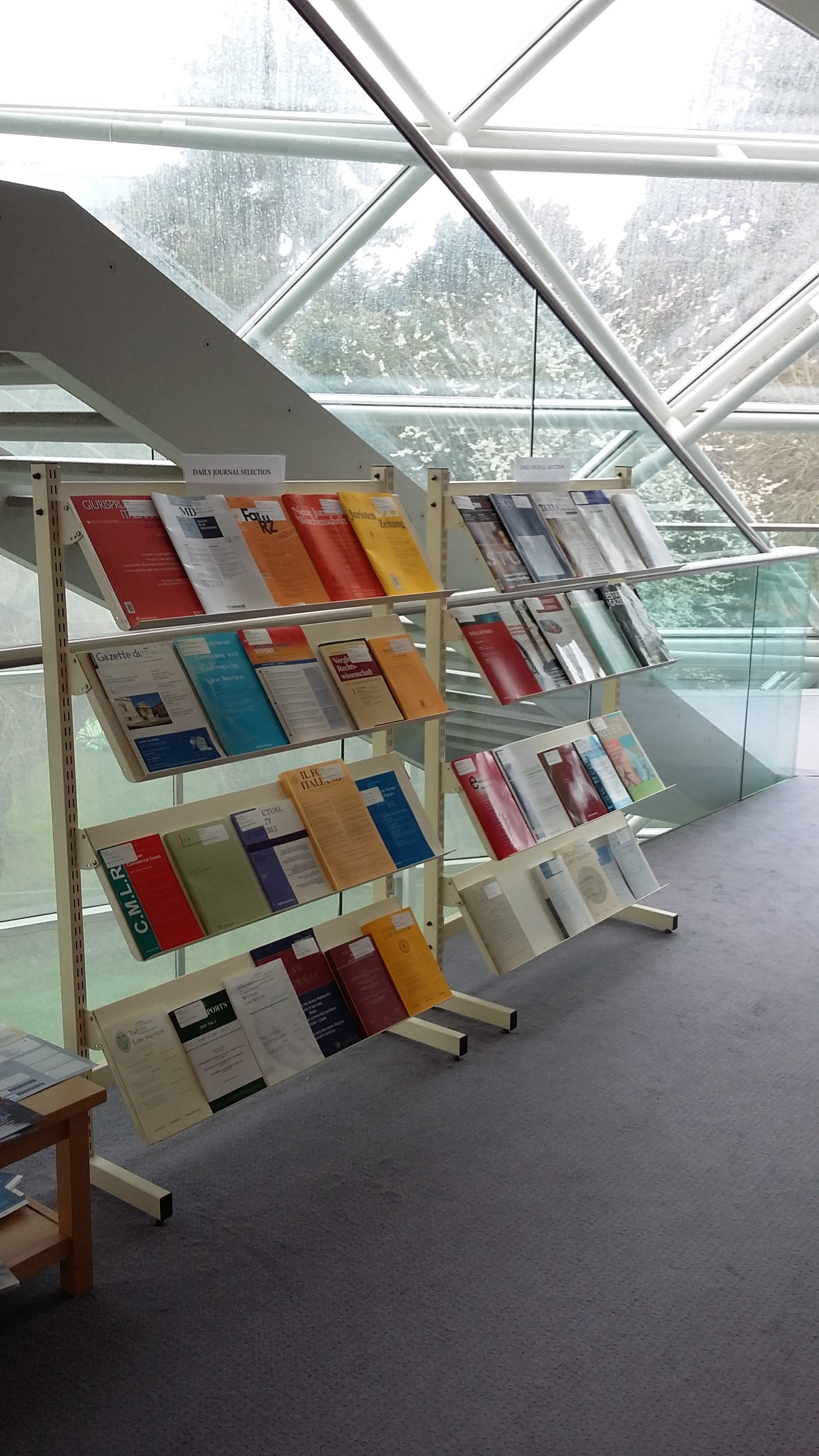 Photo of the journals display stand in the Squire Law Library where a selection of recent arrivals are displayed.