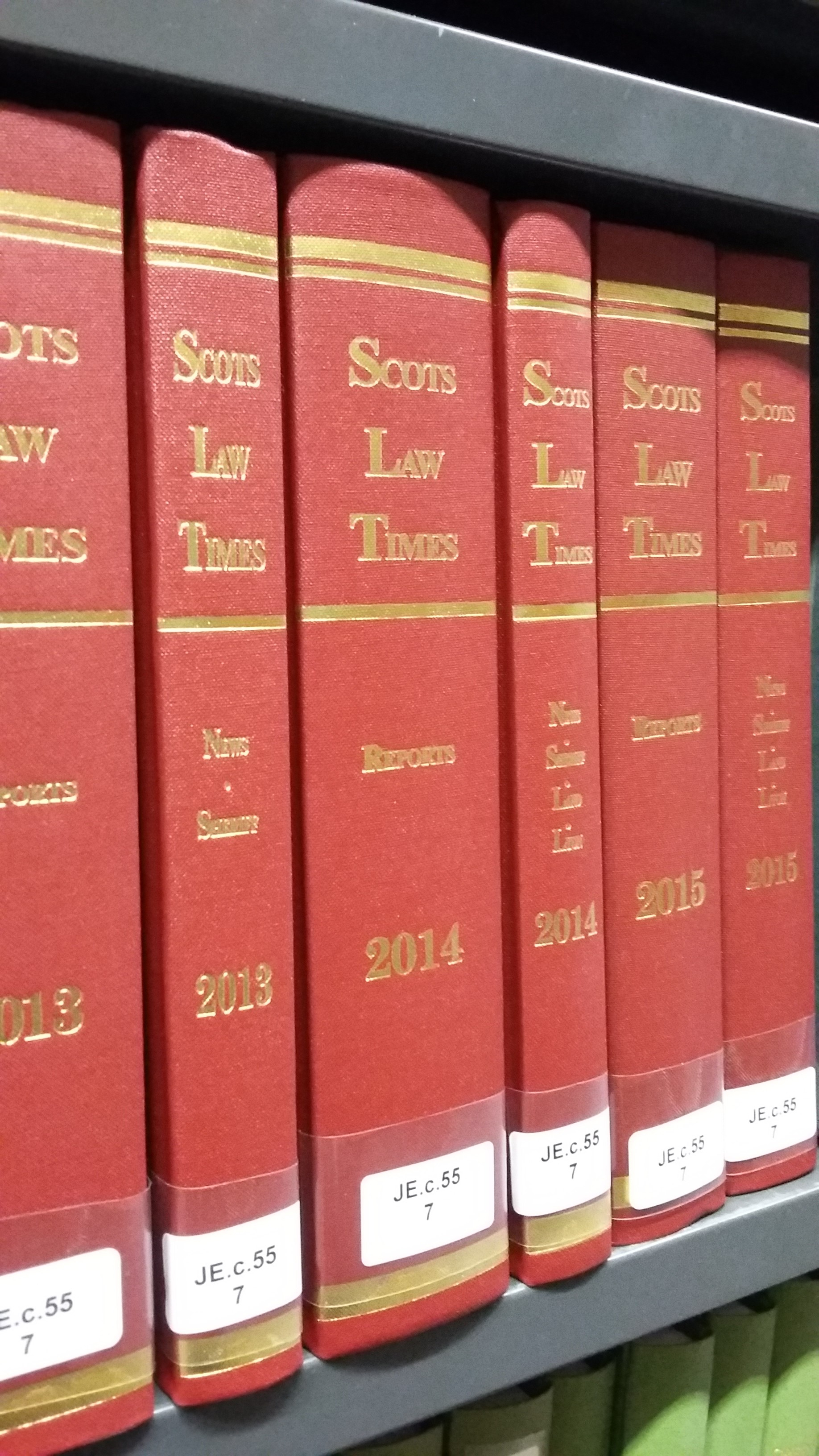 Photo of the red volumes with gold lettering of the Scots Law Times on a shelf in the Squire Law Library.