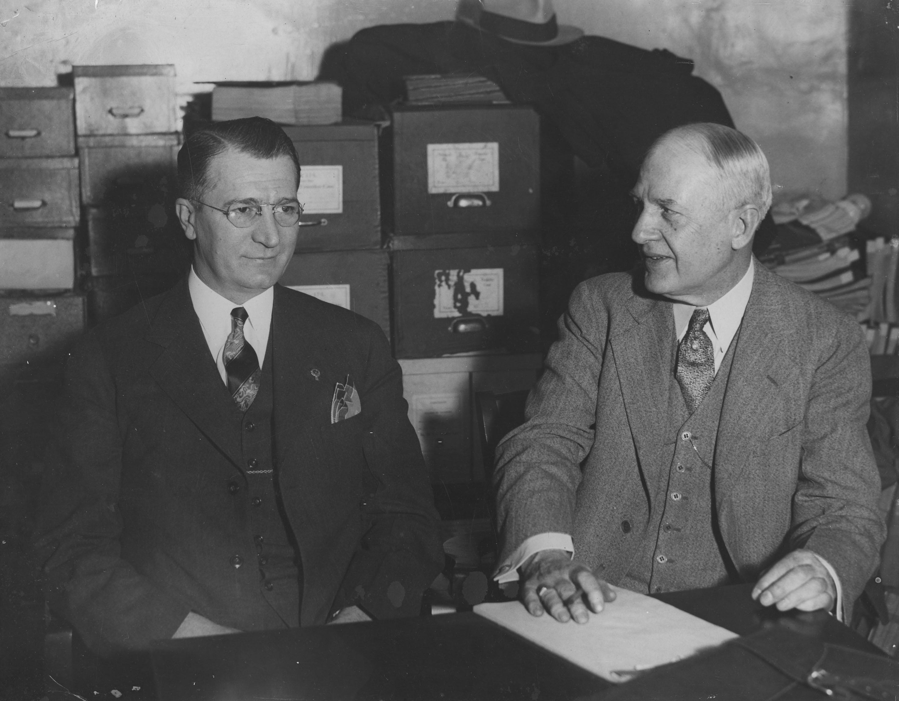 Historic photo of two men seated