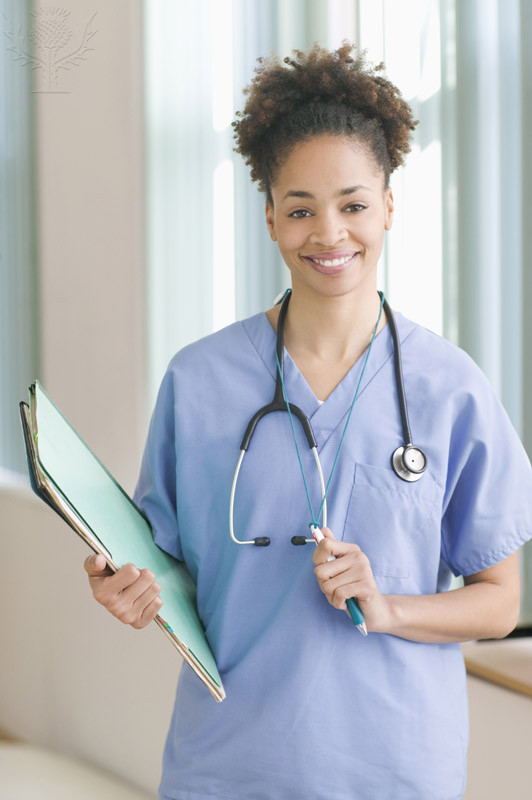 Image of female medical assistant holding medical chart