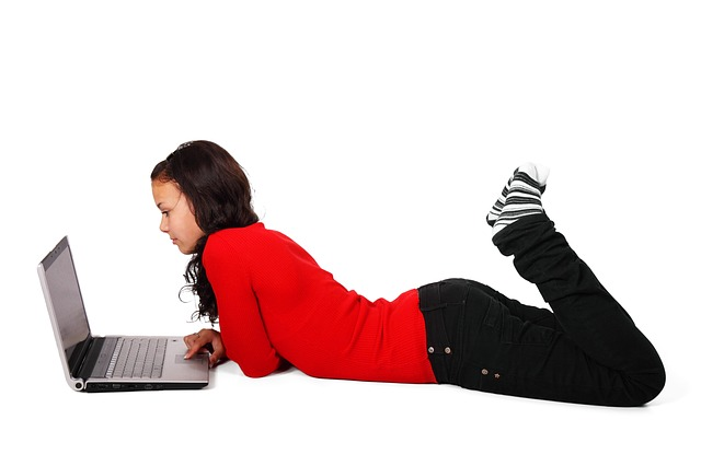 Stock photo of girl using laptop