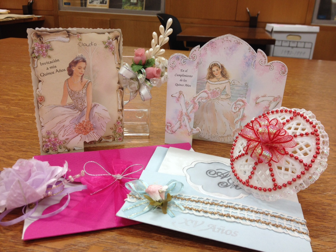A group of quinceaneras invitations.