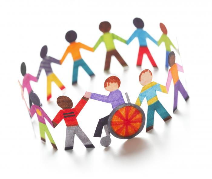 image of people from various backgrounds and abilities linking hands in a circle