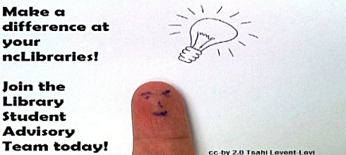 finger with face drawn on it and light bulb above