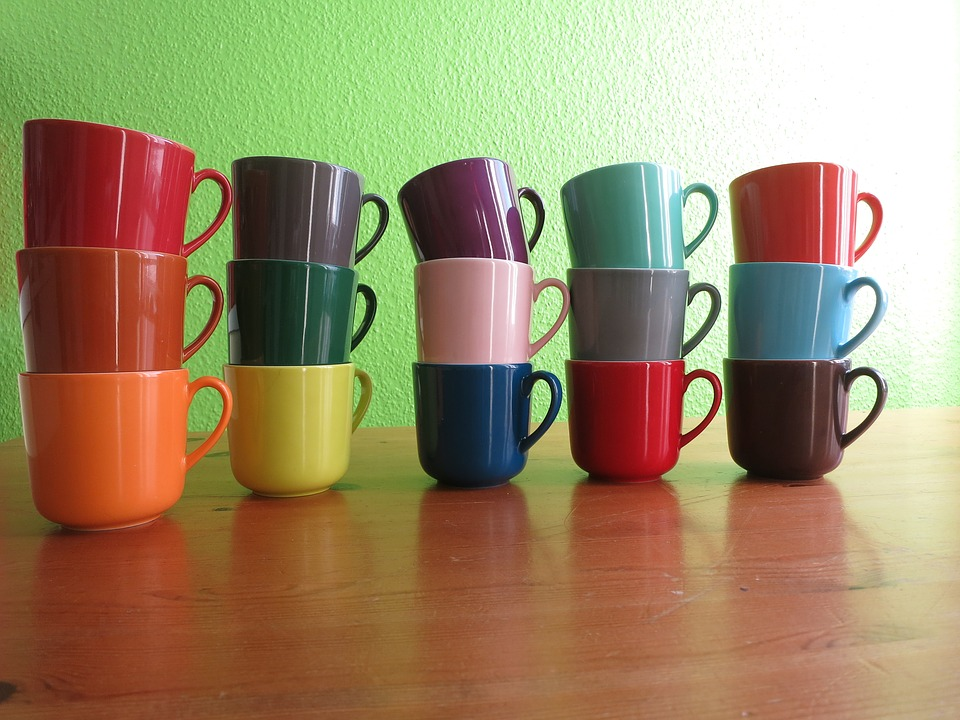 different color mugs stacked