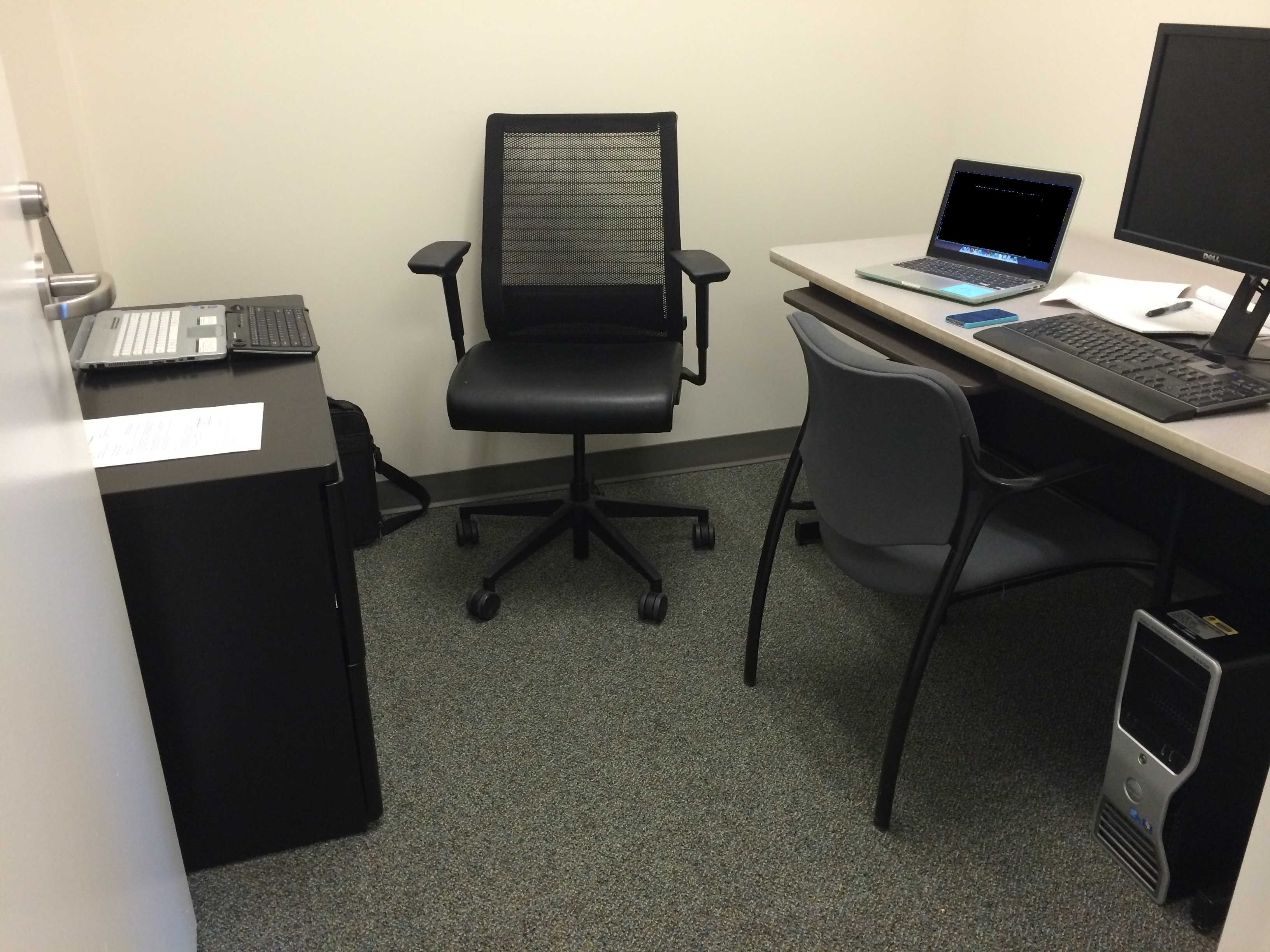 sample office technology showing a computer and several laptops