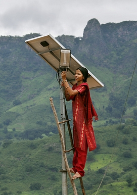Woman in India working on the solar panel for street lights