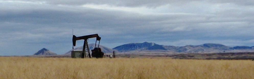 Oil pump with mountains in background