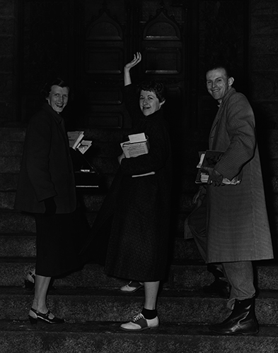 Three students on the steps of Administration Building, now College Hall, 1960.