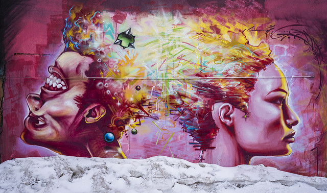 Mural with vibrant color and distorted faces