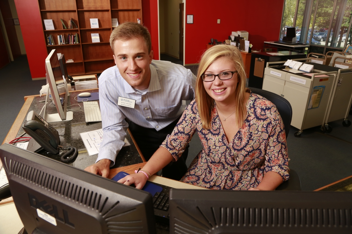 Two Information Commons student workers at the Irwin Desk