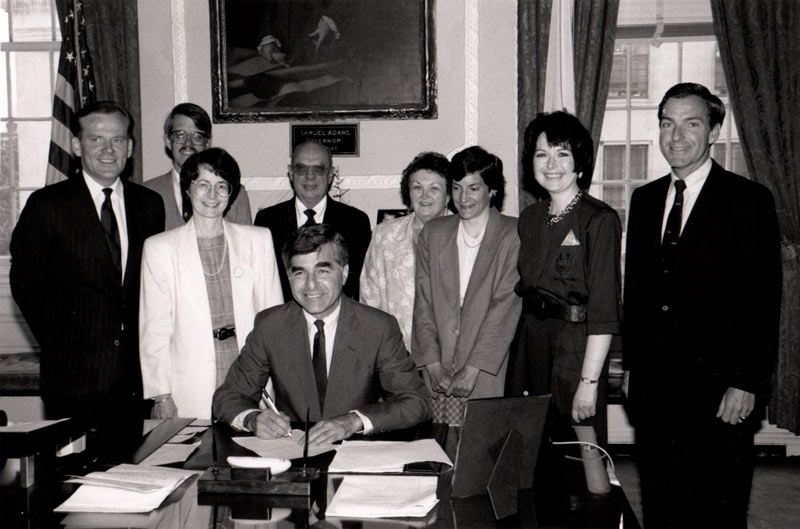 Governor Dukakis signs the Library Improvement Act into law, 1987