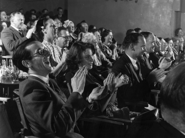 Members of an audience at the Players' Theatre at Hungerford Arches, London, 1951 - Britannica ImageQuest