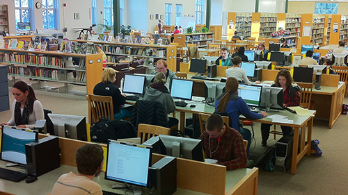 students working at library computers