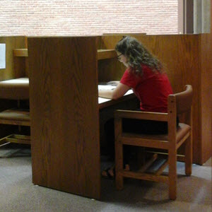 Image of a student studying in carrel