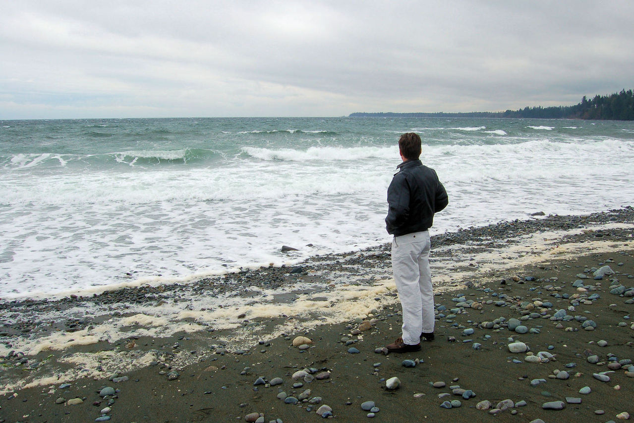 Man thinking by teh sea -
