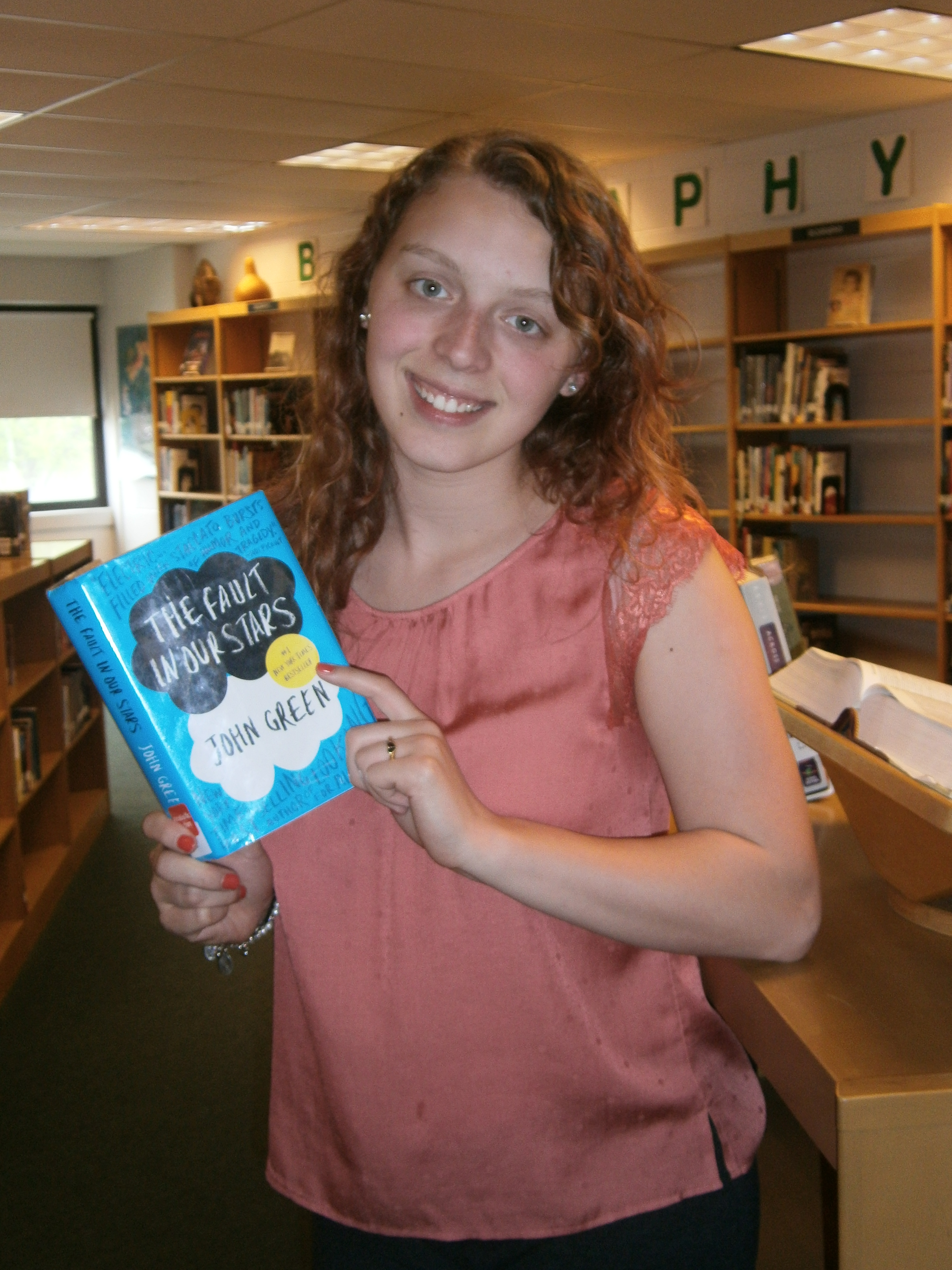 Picture of female student holding one of her favorite books