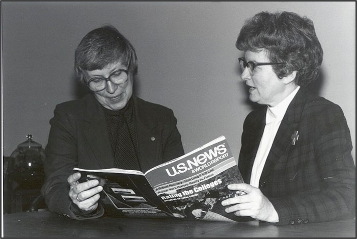 Sister Joel & Sister Austin viewing an issue of U.S. News and World Report