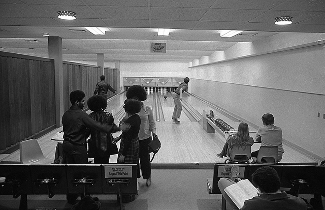 People bowling at UNO's former bowling alley in the Milo Bail Student Center