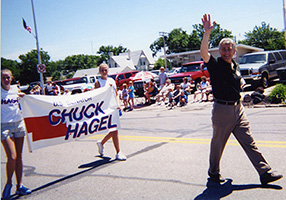 Chuck Hagel marching in a parade in North Platte while campaigning for the U.S. Senate