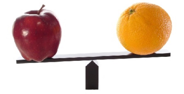 all things are not created equal - apple and orange on a balance scale