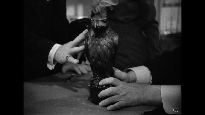 hands on the Maltese Falcon, 1941 film adaptation