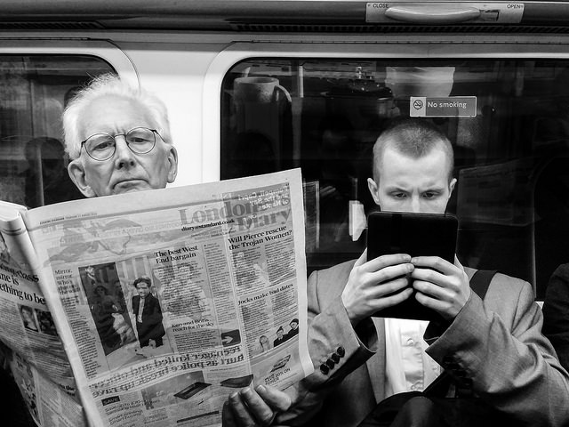 Two men reading on a train