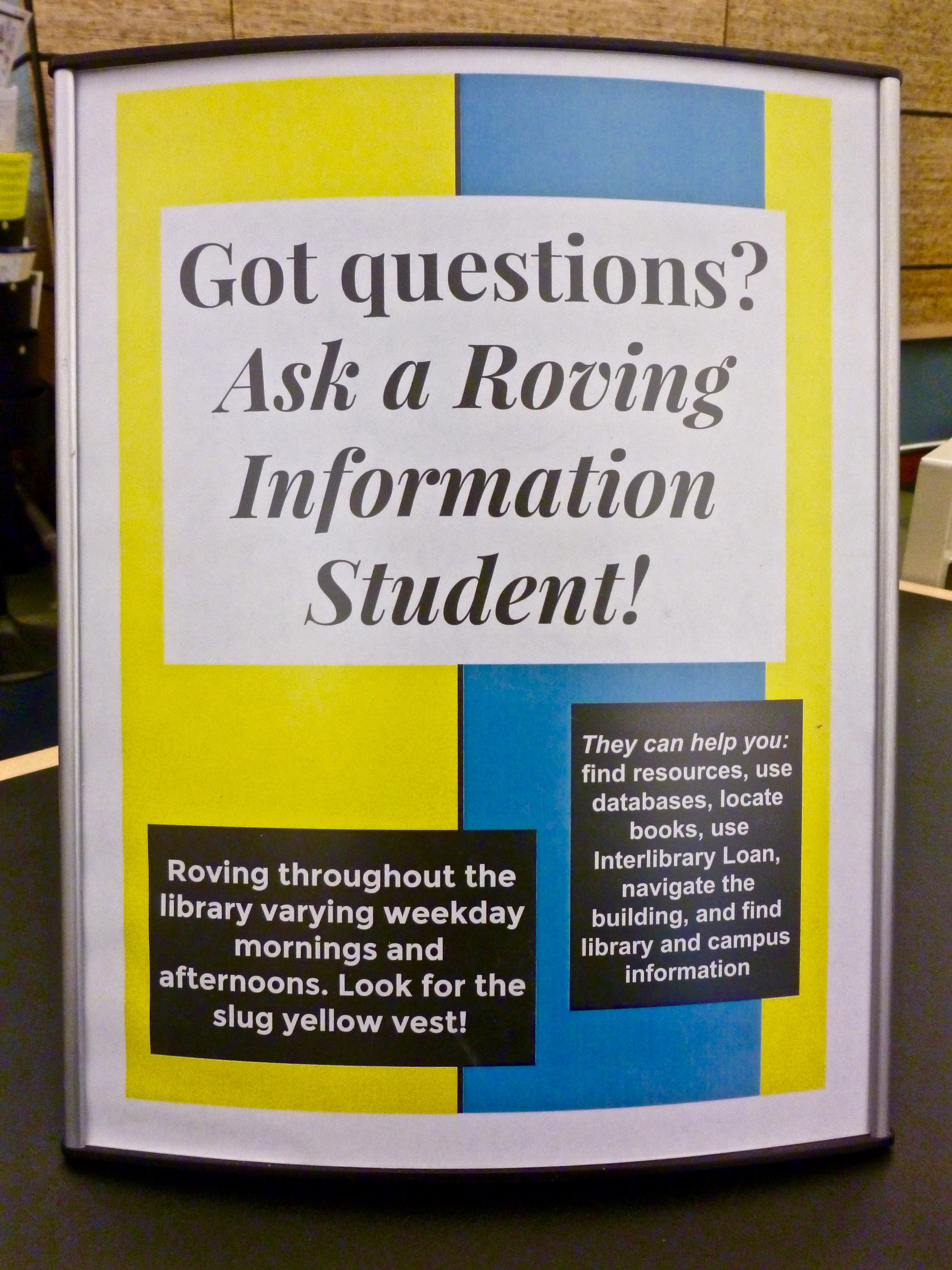 "Roving ""Got questions?"" sign"