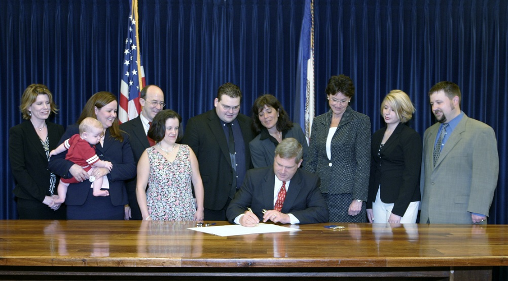 Governor Vilsack signs bill advanced by Drake Children's Rights Clinic.