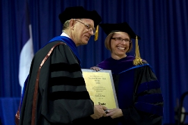 Provost Ron Troyer presents Prof. Laurie Dore a university-wide award for teaching excellence.