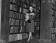 LSE Library, 'Collecting books for readers in the reserve stacks, 1964', no copyright restrictions, source: flickr (http://www.flickr.com/photos/lselibrary/3925726691/)
