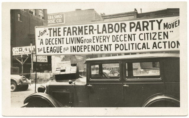 A Farmer-Labor political poster atop an automobile, 1925.
