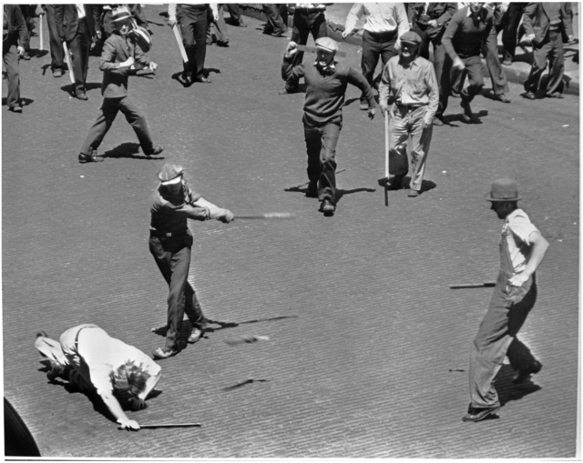 Men swinging bats and sticks during clash between striking truckers and a citizens' army, Minneapolis, 1934.