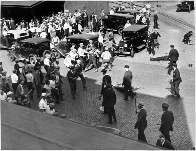 Police intervene in clash between striking truckers and the citizens' army, Minneapolis, 1934.