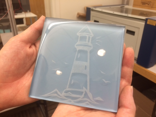 Photograph of lighthouse engraved on glass tile