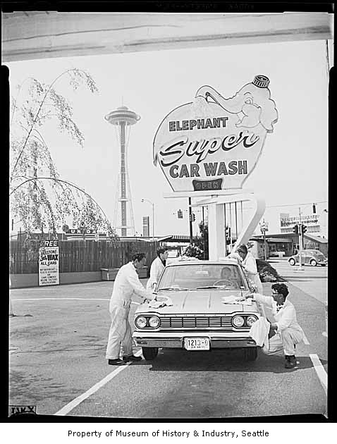 historical photo showing the space needle and the Elephant Super Carwash sign