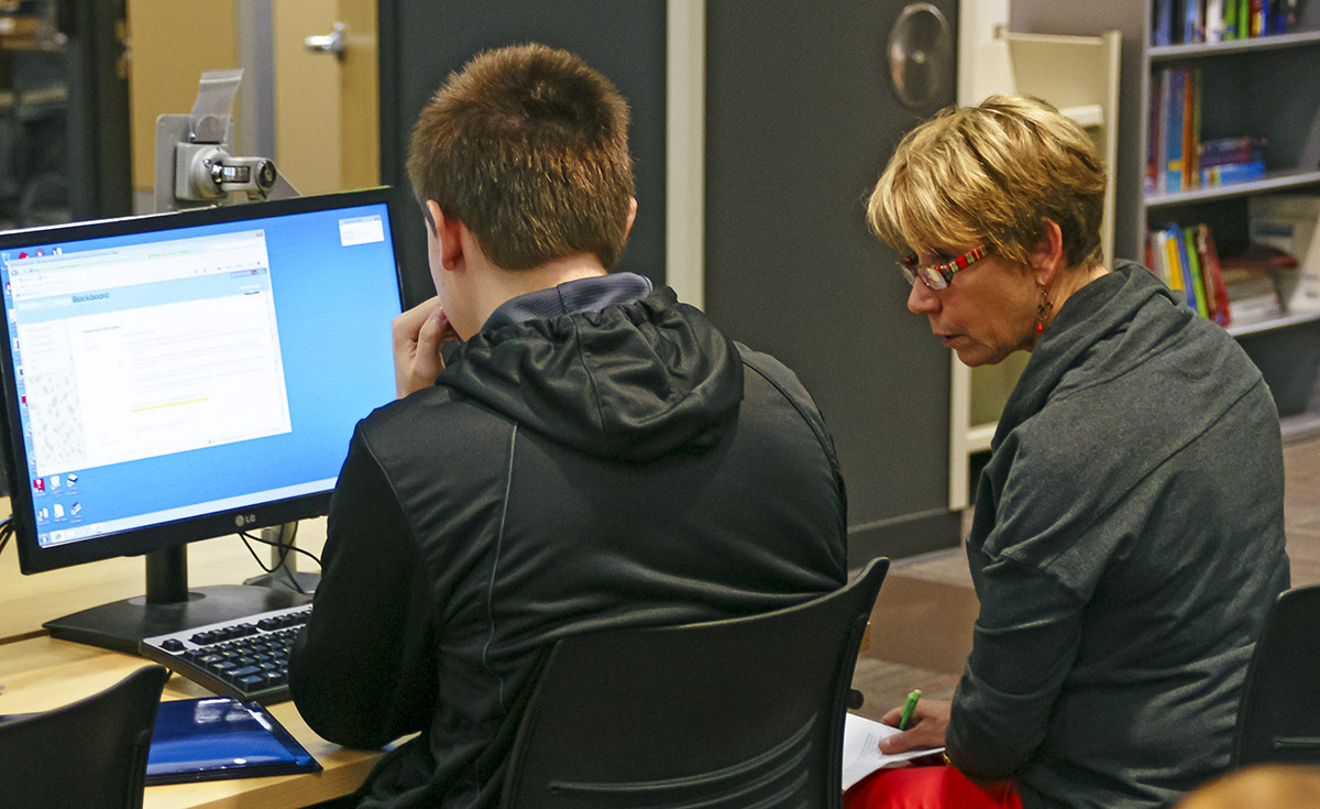 Tutor working with student at a computer