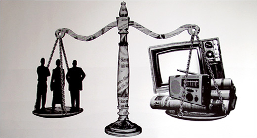 scales of justice with television, radio, and newspaper