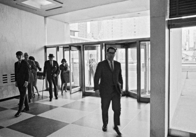 Members of the Secretariat arriving at the Secretariat Building. 14 May 1966. UN Photo # 49881